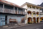 28_A_hotel_and_an_old_wooden_house